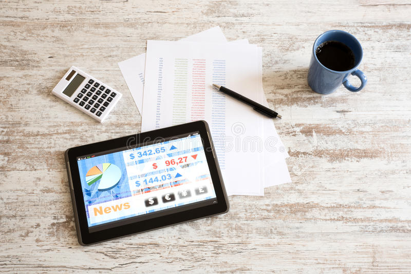Stock market trading app on a Tablet PC. Stock market trading and research software on a Tablet PC on a office Desktop stock images
