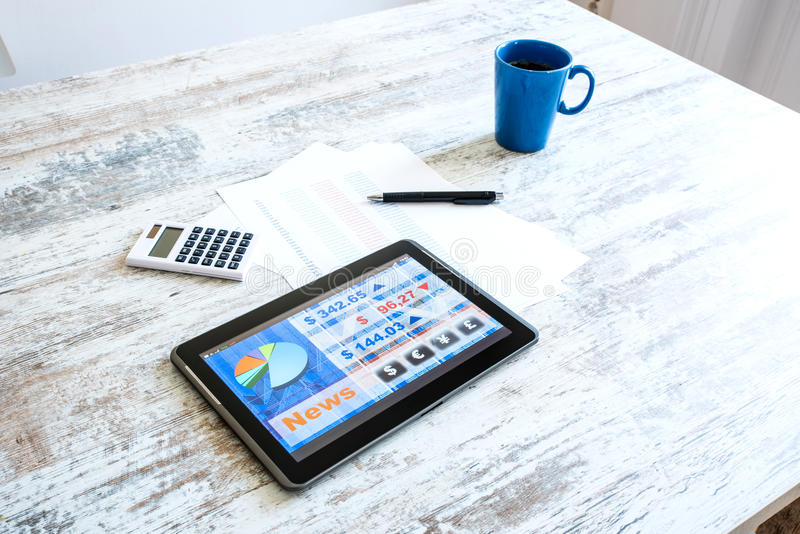 Stock market trading app on a Tablet PC. Stock market trading and research software on a Tablet PC on a office Desktop stock image