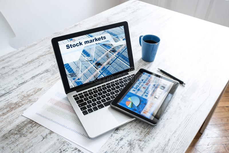 Stock market trading app on a Tablet PC and Laptop PC. Stock market trading and research software on a Tablet PC with a Laptop computer stock image