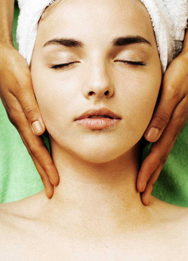 Stock photo attractive lady getting spa treatment in salon. Close up asian hands on face royalty free stock photos