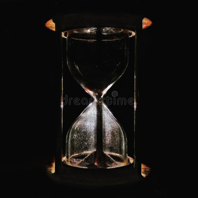 Stock photo of a dark sand hourglass royalty free stock photo