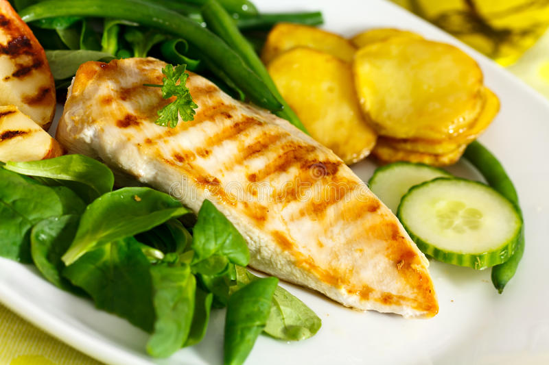Stock Photo: grilled chicken breast with green bea royalty free stock images