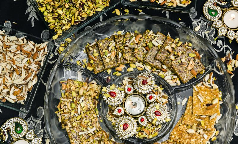 Stock photo of Indian sweets served in silver or wooden plate. variety of Peda, burfi, l stock photos