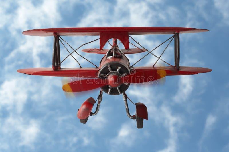 Stock Photo of a model plane. A model plane on clowed background. grumman g-5 1933 plane stock photo