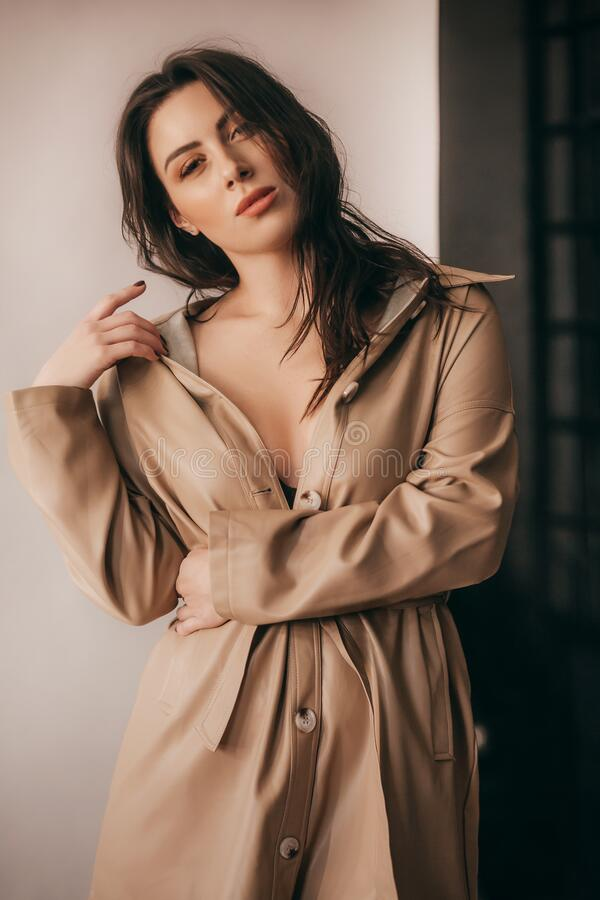 Portrait of beautiful young woman with makeup in fashion clothes stock photography