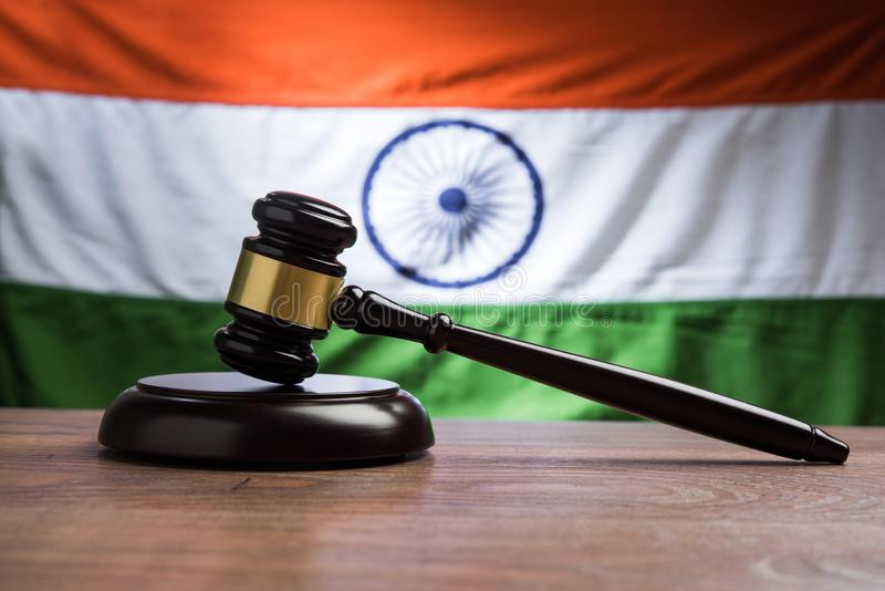 Stock photo showing Indian low and jurisdiction - Indian national flag or tricolour with wooden gavel showing concept of law in In royalty free stock images