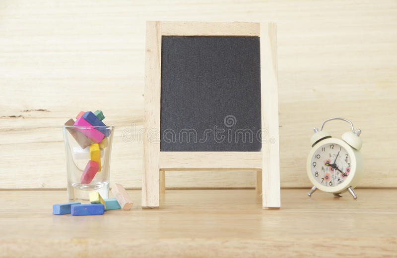 Stock Photo:Still life with empty blackboard and colored chalks stock photos