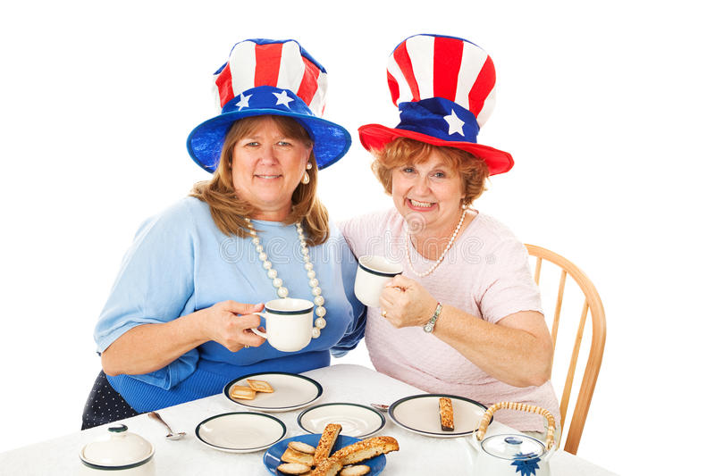 Stock Photo of Tea Party Conservatives. Conservative American voters sitting down to an actual tea party. White background stock photography