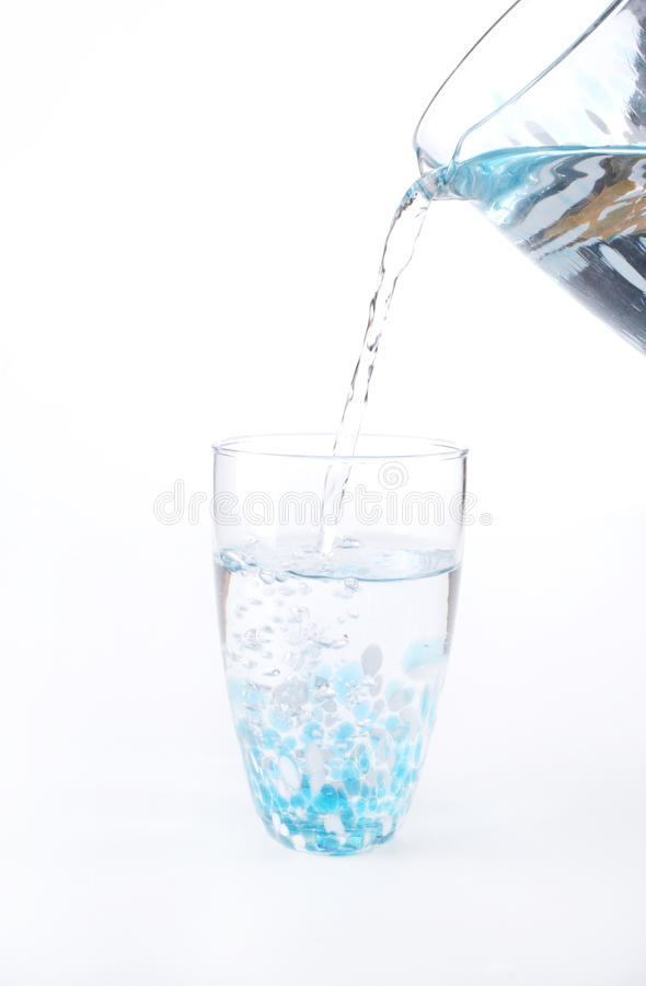 Stock photo of water being poured into a glass royalty free stock photography