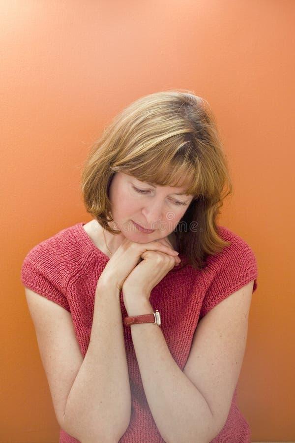Stock Photo of a Woman on Orange Background stock photo