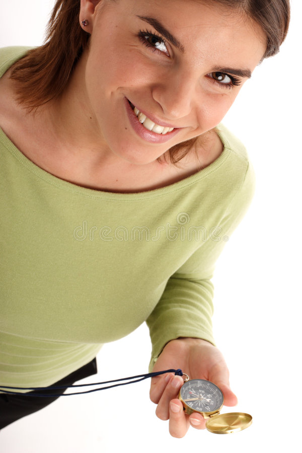 Stock photo of a young woman with compass royalty free stock photography