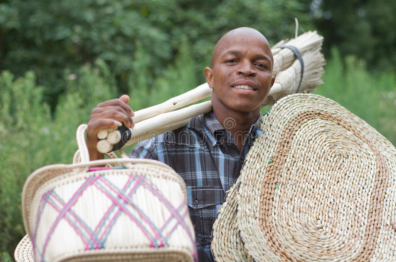 Stock photograph of South African entrepreneur small business broom salesman. Stock photograph of a black South African entrepreneur small .business broom stock photography