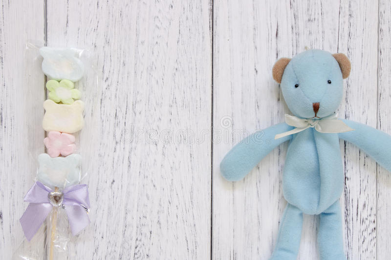 Stock Photography flat lay vintage white painted wood table blue. Bear doll cotton candy stock images