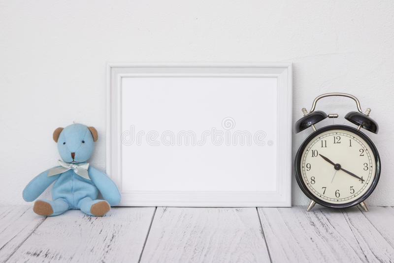 Stock photography white frame vintage painted wood table cute bl. Ue bear stock image