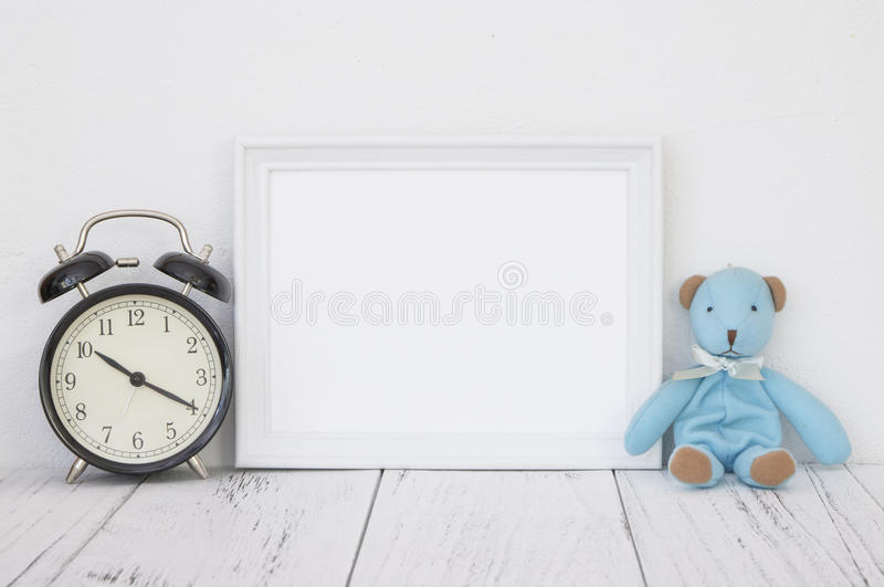 Stock photography white frame vintage painted wood table cute bl. Ue bear black alarm clock royalty free stock photos