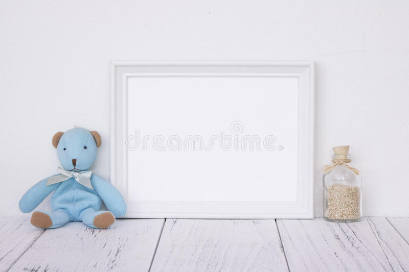 Stock photography white frame vintage painted wood table cute bl. Ue bear glass bottle with sand inside stock images