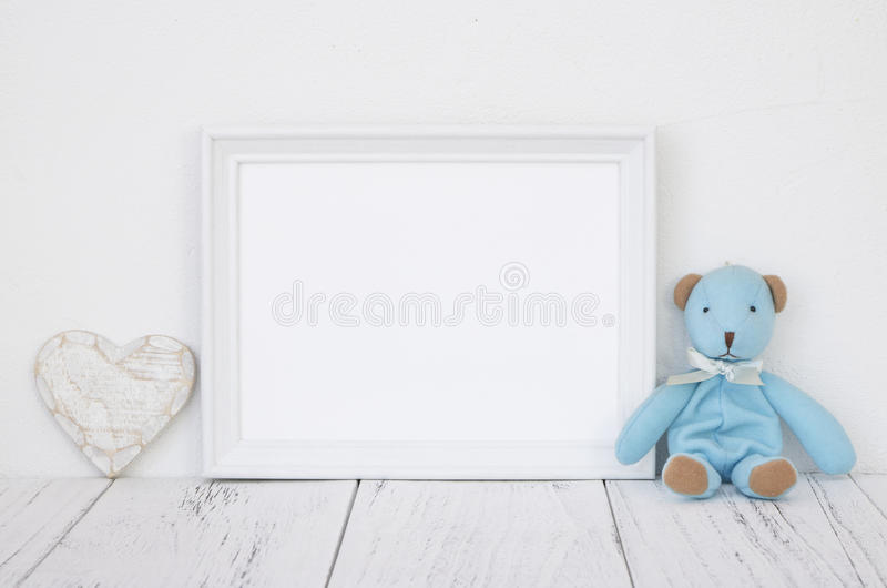 Stock photography white frame vintage painted wood table cute bl. Ue bear heart retro craft stock image