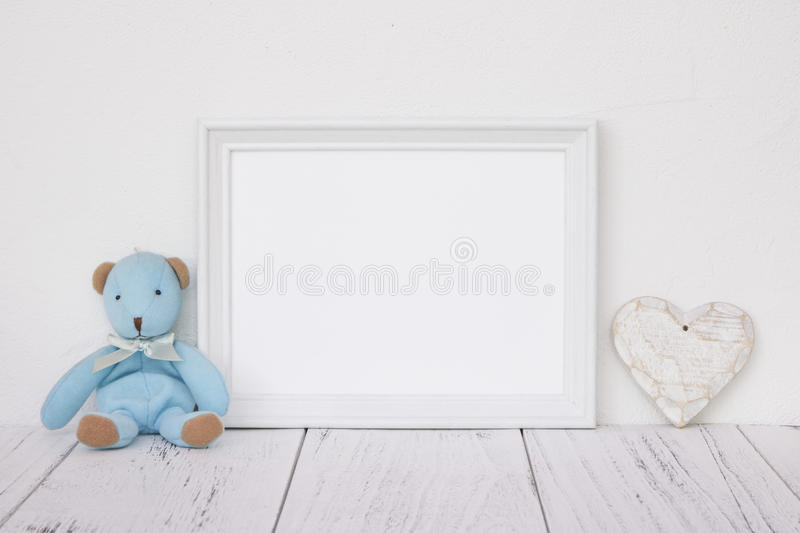 Stock photography white frame vintage painted wood table cute bl. Ue bear heart retro craft royalty free stock photos