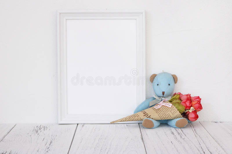 Stock photography white frame vintage painted wood table cute bl. Ue bear holding rose flower royalty free stock photography