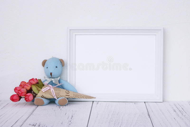 Stock photography white frame vintage painted wood table cute bl. Ue bear holding rose flower stock photos