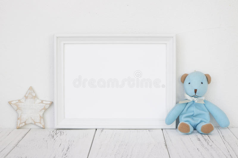 Stock photography white frame vintage painted wood table cute bl. Ue bear star retro craft royalty free stock photos