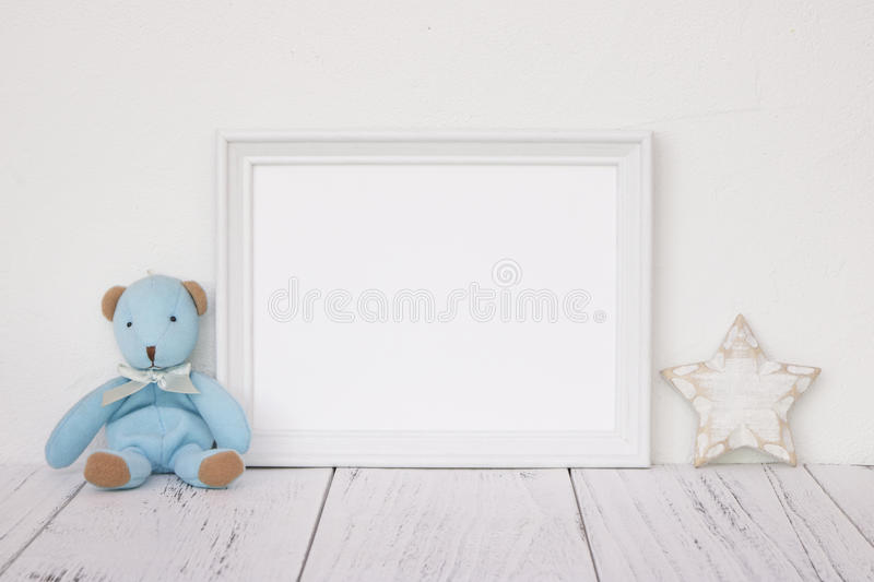 Stock photography white frame vintage painted wood table cute bl. Ue bear star retro craft royalty free stock image