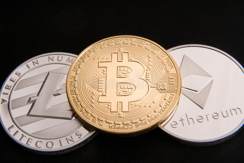 Stock of physical bitcoins, btc, bitcoin, ethereum, litecoins, gold and silver coins, cryptocurrency concept royalty free stock images
