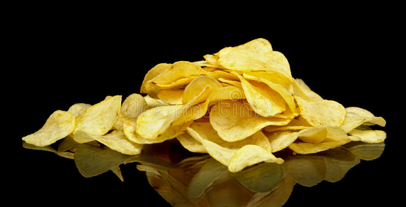 Stock of potato chips on black background royalty free stock photos