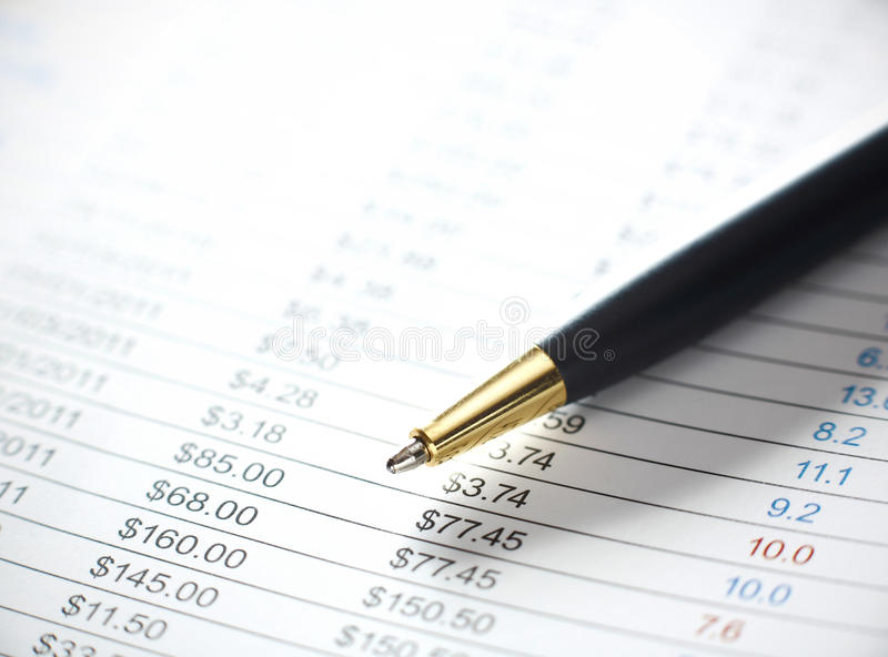 Stock price. List with ball pen royalty free stock image