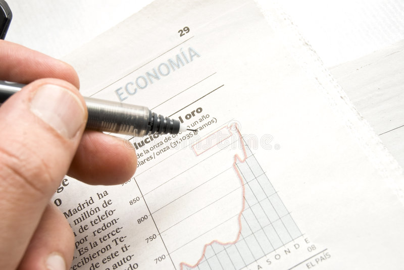 Stock price chart. Close up shot of a pen on stock price chart royalty free stock image
