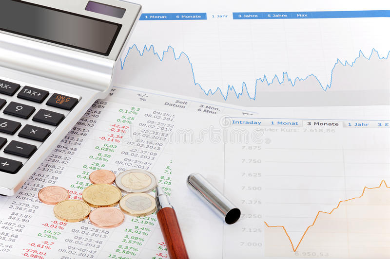 Stock Quotes, Calculator And Money On Desk Royalty Free Stock Photography