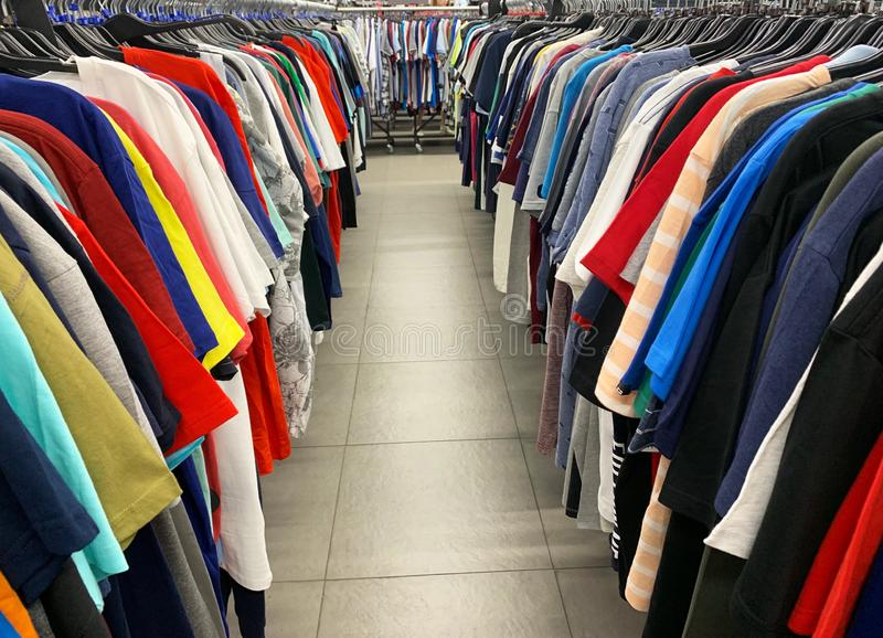 Stock retail store of branded clothes with a discount of last year`s collection, mobile image.  royalty free stock photography