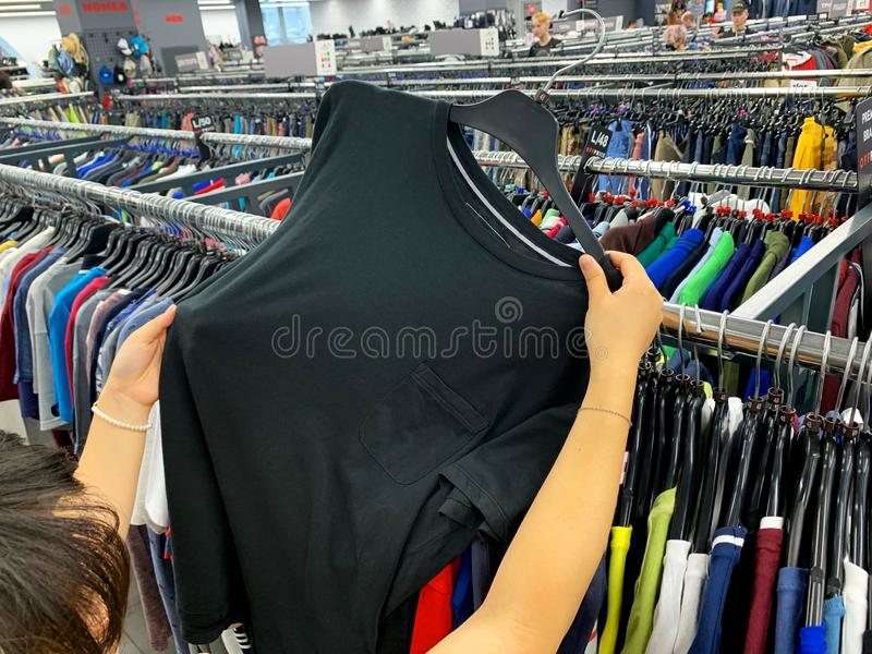 Stock retail store of branded clothes with a discount of last year`s collection, mobile image.  stock image