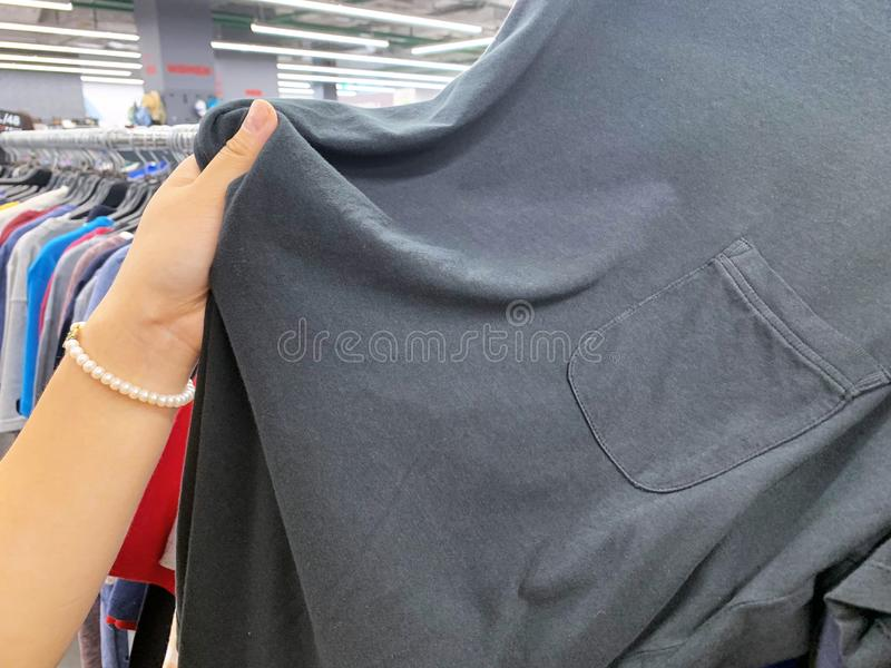 Stock retail store of branded clothes with a discount of last year`s collection, mobile image.  royalty free stock image