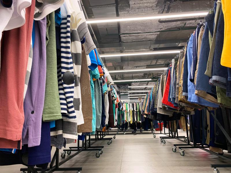 Stock retail store of branded clothes with a discount of last year`s collection, mobile image.  royalty free stock photos