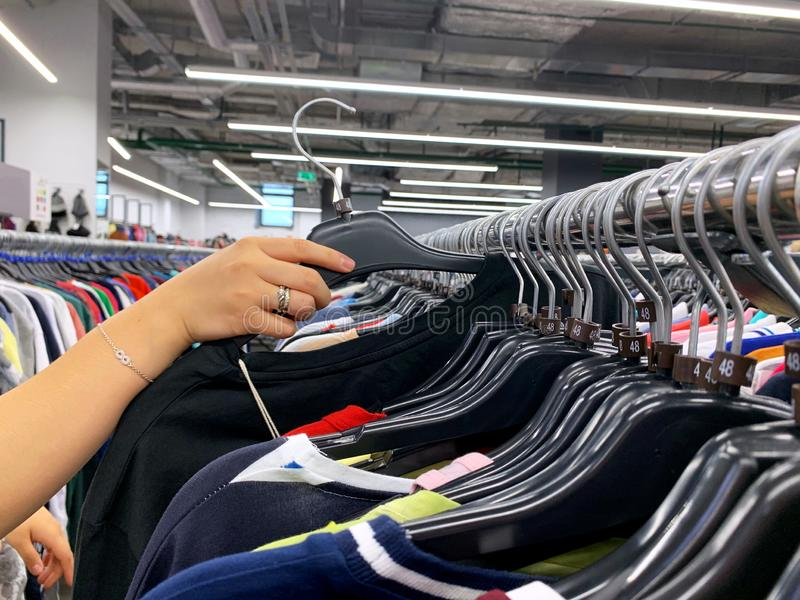 Stock retail store of branded clothes with a discount of last year`s collection, mobile image.  stock photography