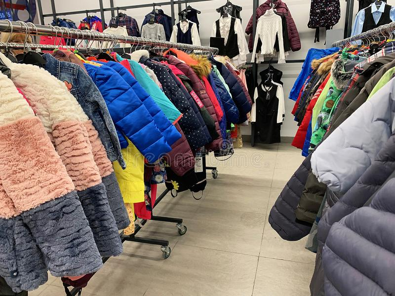 Stock retail store of branded clothes with a discount of last year`s collection, mobile image.  royalty free stock photo