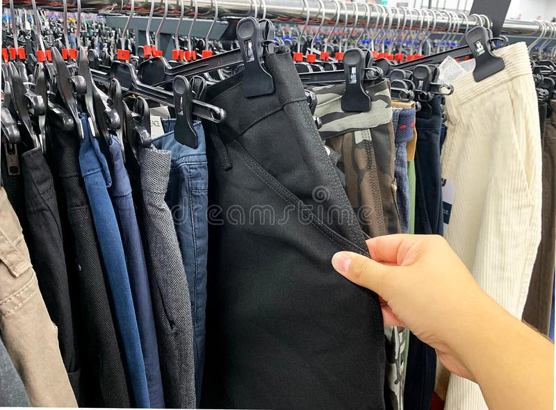 Stock retail store of branded clothes with a discount of last year`s collection, mobile image. Stock retail store of branded clothes with a discount of last year royalty free stock photos