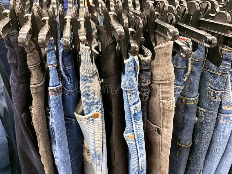 Stock retail store of branded clothes with a discount of last year`s collection, mobile image.  stock photo