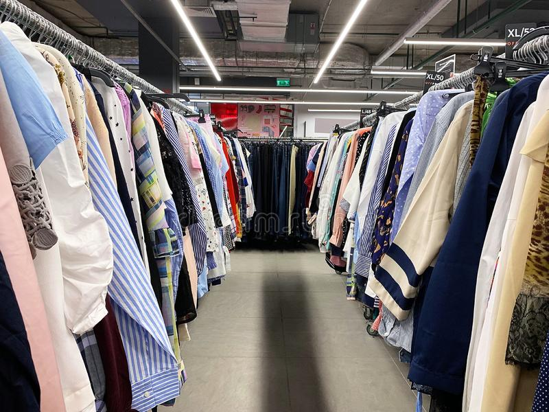 Stock retail store of branded clothes with a discount of last year`s collection, mobile image.  royalty free stock images