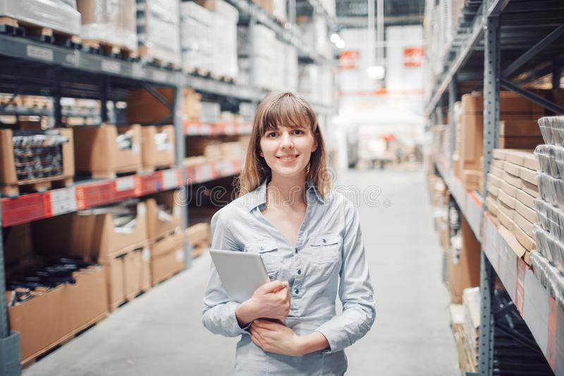 Stock taking. beautiful young woman worker of furniture store. stock image