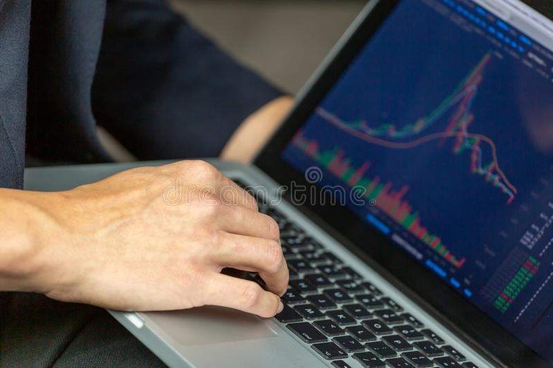 Stock Trader with Chart. Stock Trader Looking At Stock Chart on Screen royalty free stock image