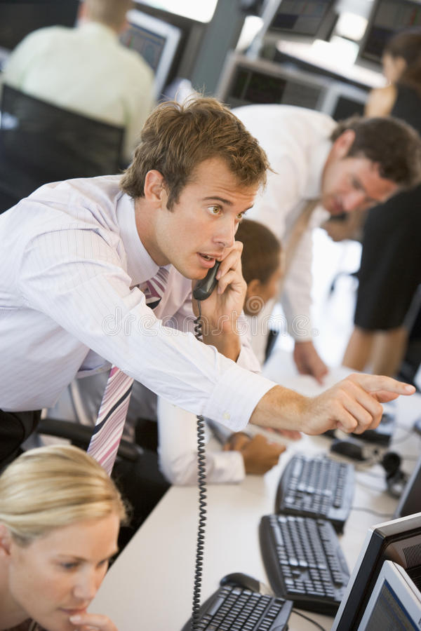 Stock Trader On The Phone. Pointing royalty free stock images