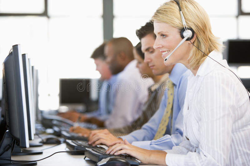 Stock Traders With Headsets At Work Royalty Free Stock Images