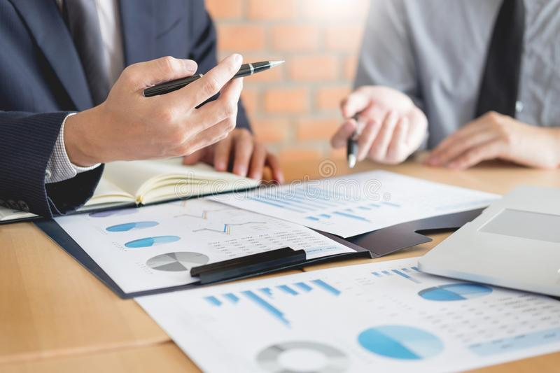 Stock traders looking at finance analysis marketing report trading stocks online in office.  royalty free stock photos