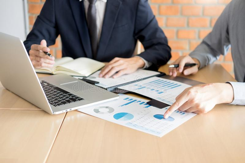 Stock traders looking at finance analysis marketing report trading stocks online in office.  royalty free stock photo