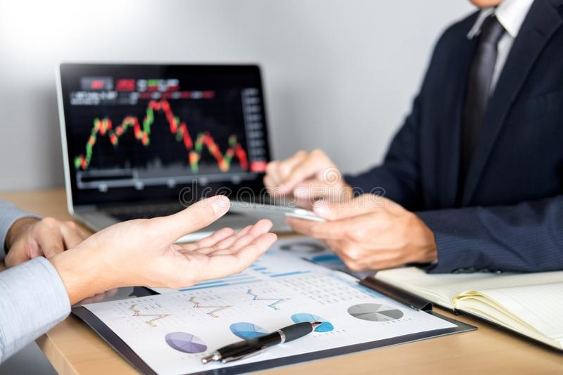 Stock traders looking at finance analysis marketing report trading stocks online in office.  stock images