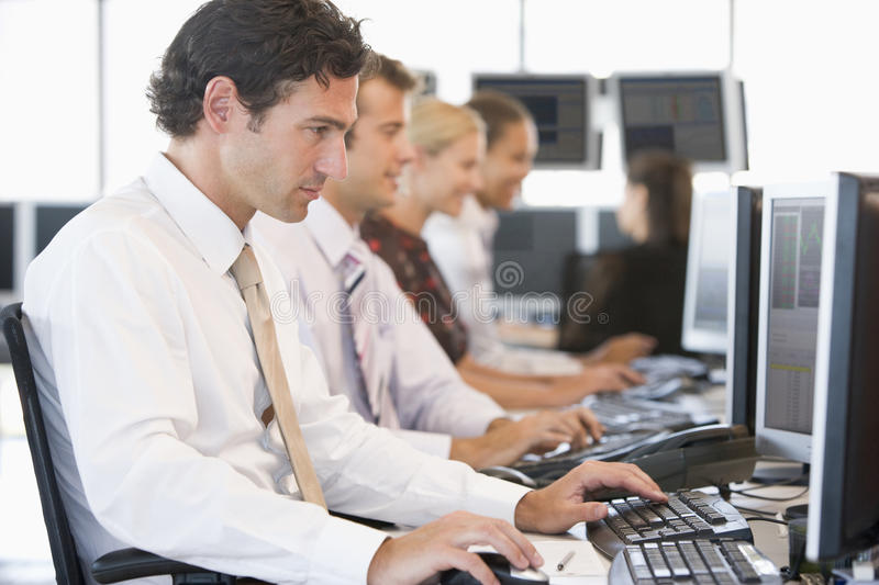Stock Traders Working At Computers. During day royalty free stock photos