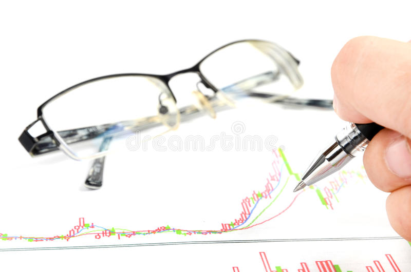 Stock trading. Glasses and pen with stock trading stock photo