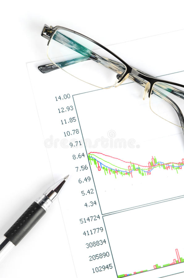 Stock trading. Glasses and pen with stock trading royalty free stock image